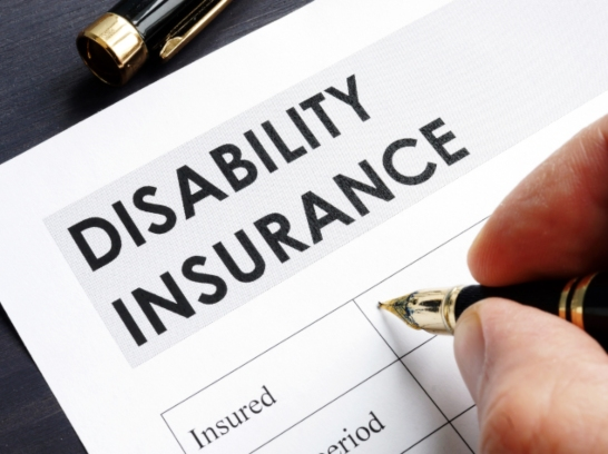 Disability Insurance form being filled out.