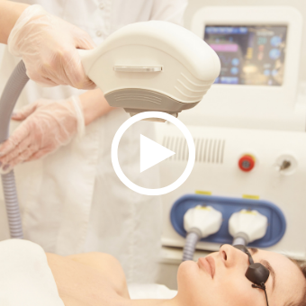 Esthetician performing IPL — IPL photo rejuvenation and photofacials with play button overlay